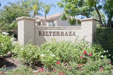 NEW PRICE REDUCTION!  Limited availability 3 bedroom corner townhouse style unit located in the resort style golf course community of Belterraza.  Enjoy the community amenities along a serene, parklike setting as well as the lake, lagoon, pools, parks, tennis courts, biking and hiking trails of Rancho Santa Margarita City Association.  Spacious home with vaulted ceilings, skylights, cozy fireplace, formal dining area, private blocked wall paved patio, balcony, and two-car direct access garage.  Centrally located for commuters and within the desirable Capistrano Unified School District!
